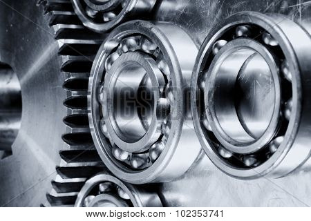 titanium and steel ball-bearings and gears in metallic selenium toning.