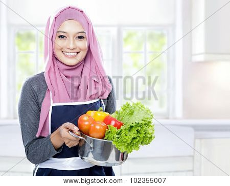 Housewife Carrying A Pan Full Of Vegetables