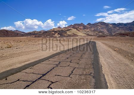 Patchy asphalt road, Artists Drive, Death Valley National Park poster