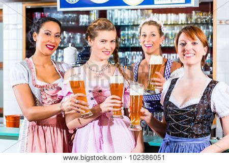 Innkeeper and guests drinking beer in Bavaria