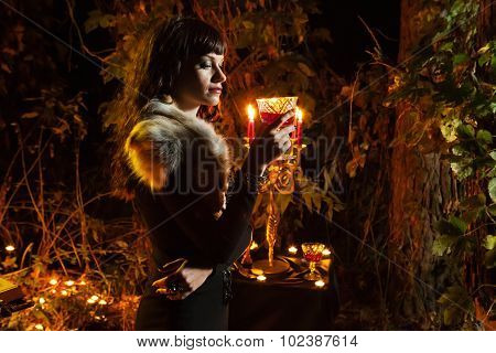 Beautiful Witch Is Going To Drink A Magic Wine Somewhere Deep In Forest.