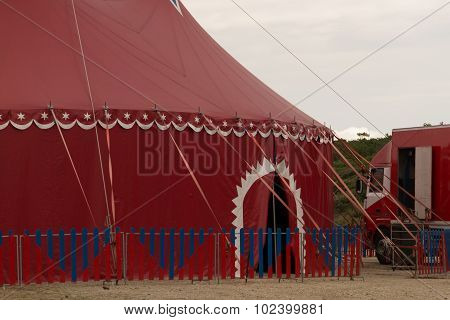 Big Red Top Circus Tent On A Field In A Park,