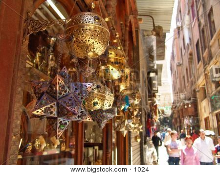 Metal Lamps hanging in a open air marketplace poster