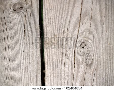 The weathered wooden plank with twigs background