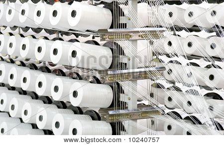 Spools Of Thread On A Loom