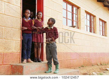 Malealea, Lesotho - August, 27th, 2015: local school; students during a break.