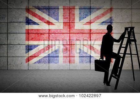 Silhouette of businesswoman climbing ladder against union jack flag in grunge effect