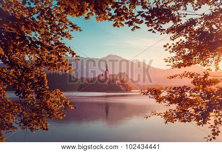 Little Island With Catholic Church In Bled Lake, Slovenia  At Sunrise