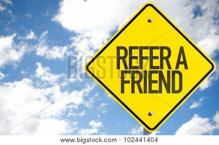 Refer a Friend sign with sky background