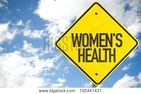 Womens Health sign with sky background