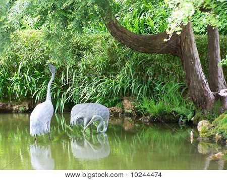 Crane Statuary in Garden Pond