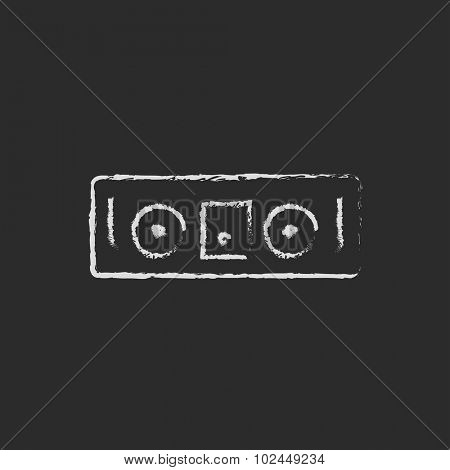 DJ console hand drawn in chalk on a blackboard vector white icon isolated on a black background.