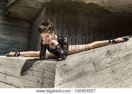 Graceful ballerina sitting in the cross splits