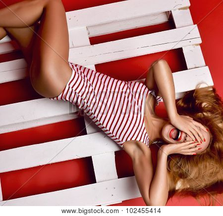 Sexy Woman Posing Lying In Summer Fashion Body Cloth Laughing On Wooden Pallet