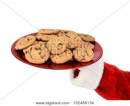 Closeup of Santa Claus hand holding a tray of cookies over a white background.