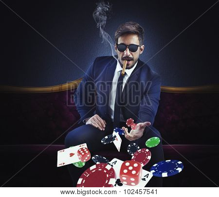 Rich gambler throws cards dice and chips poster