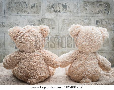 Teddybears holding hands