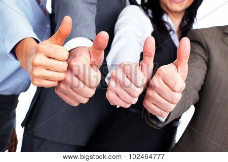 Hands of happy business people with thumbs.