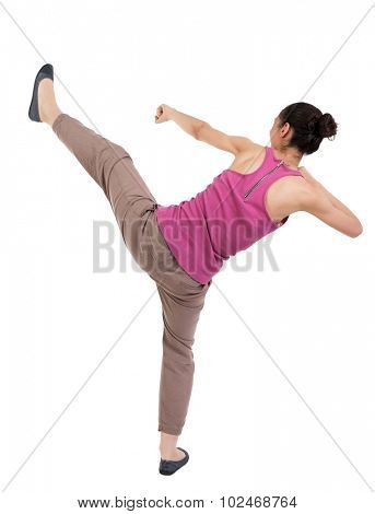 skinny woman funny fights waving his arms and legs. Rear view people collection.  backside view of person.  Isolated over white background. African-American woman has a leg up