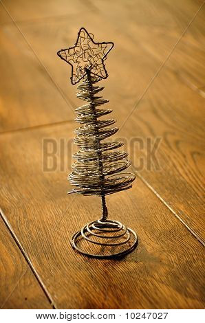 Silver Christmas Tree On A Wooden Floor