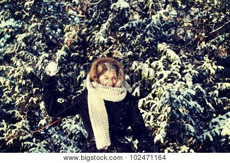 Teenage woman playing snowball fight poster