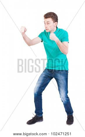 skinny guy funny fights waving his arms and legs. Isolated over white background. Funny guy clumsily boxing. Enraged man in a boxing pose. poster