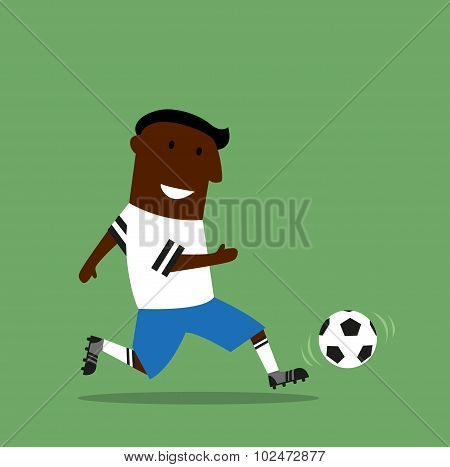 Football or soccer player dribbling a ball