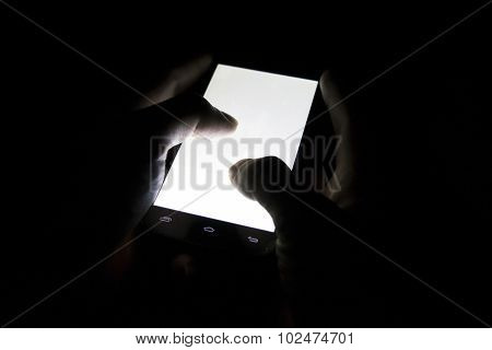 finger touch white screen Mobile telephone in the darkroom