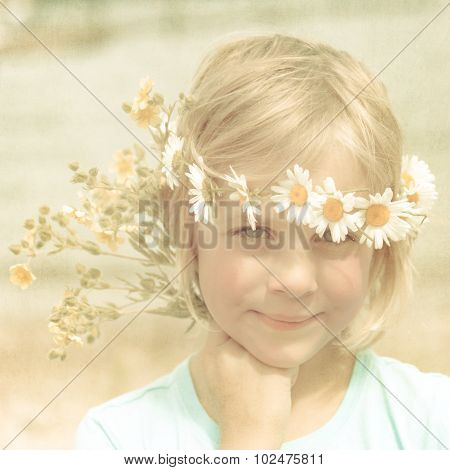 Textured Retro Portrait Of Pretty Little Blonde Girl With A Crown Of Daisies