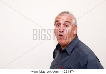 Older Man Looks Surprised
