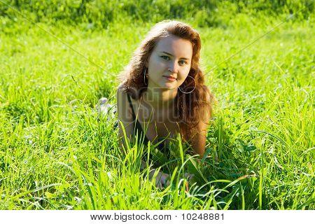 Brunette Model Laying In Meadow