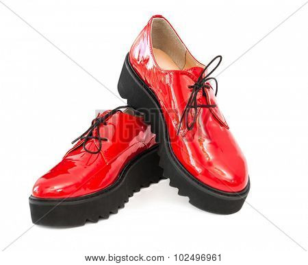 red patent leather boots isolated on white background