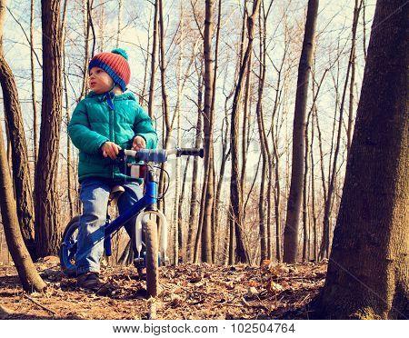little boy on running bike outdoors, kids sport