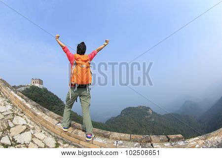 cheering hiking woman hiker open arms on chinese great wall