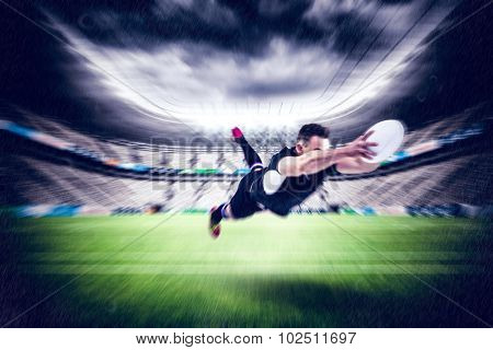Rugby player scoring a try against rugby stadium poster