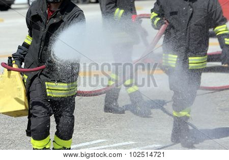 Firefighters With The Fire Extinguisher During A Practice Session
