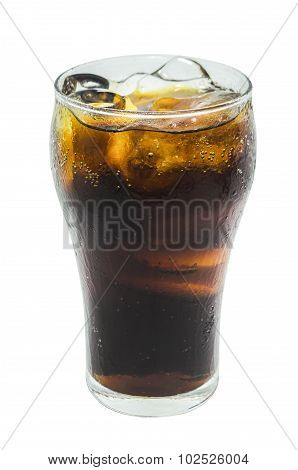A soft drink in glass on white background.