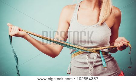 Fitness Girl Measuring Her Body With Tapes