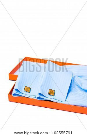 Orange silver cuff links and men's shirt sleeve detail