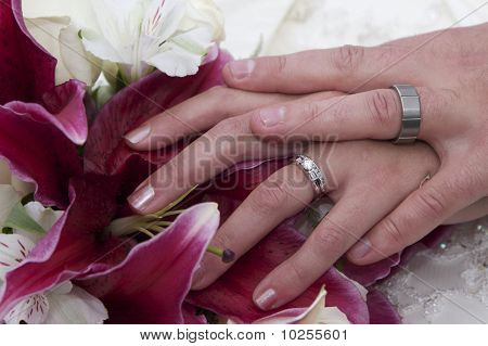 Wedded hands on a bouquet