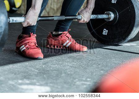 Man Practicing Weight Lifting