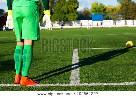 Football Goalkeeper In Green Form And With Shadow
