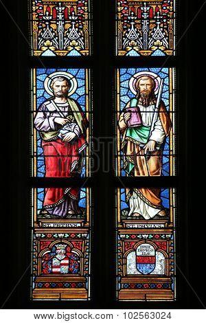 ZAGREB, CROATIA - NOVEMBER 21: Saint Peter and Paul, stained glass window in parish church of Saint Mark in Zagreb, Croatia on November 21, 2014