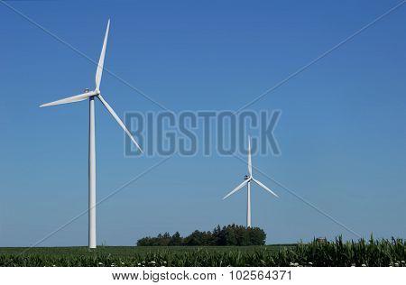 Two Wind Turbines in a Corn Field