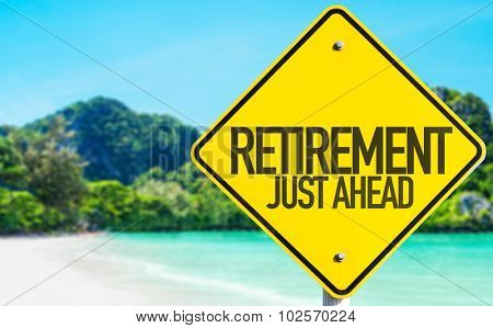 Retirement Just Ahead sign with beach background