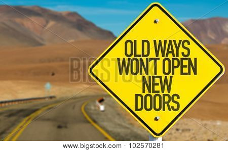 Old Ways Wont Open New Doors sign on desert road