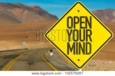 Open Your Mind sign on desert road