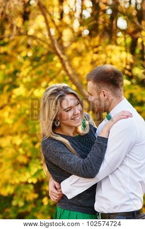 Falling in love autumn. embracing couple