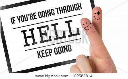 Composite image of motivational message by crossed fingers