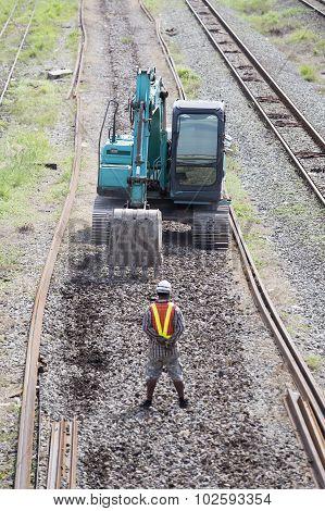 Excavator On Railroad Work